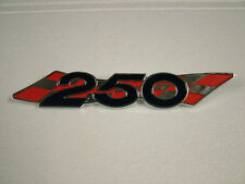 SUZUKI TS 250 R/J, '71, '72 SIDE COVER BADGE, NEW CAST REPRODUCTION.