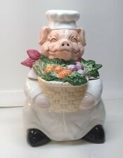 Pig Cookie Jar With Vegetables Lying Around His Neck In A Basket
