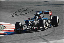 Romain Grosjean SIGNED 12x8  F1 Lotus-Mercedes E23, Barcelona Testing 2015