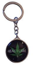 Black and Green Marijuana Pot Leaf Keychain with THC Healthcare Logo