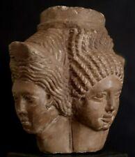 Four Faces Limestone Statue