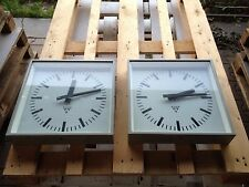 pair of vintage pragotron clock