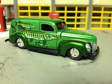 1/64 40 Ford Del.Van in Candy Green with Murals of Fish with Rubber Tires