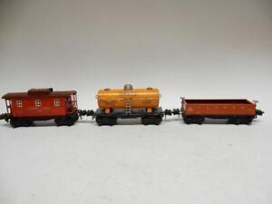 3 PREWAR LIONEL FREIGHT CARS: 2657 CABOOSE, 2652 GONDOLA & 2654 SHELL TANK CAR