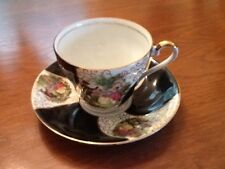Bone China Teacup and Saucer Black exterior with Couple In Period Garden Scene
