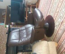 Brown reclining armchair