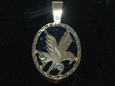 10k Gold pendant with an eagle on a blue spinel background