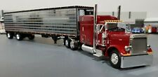 1/64 DCP PETERBILT 379 CHRISTENSEN TRUCKING WITH SPREAD AXLE TRAILER NEW IN BOX
