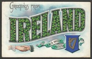 Postcard Ireland harp crest Greetings From hand clasp Posted 1906