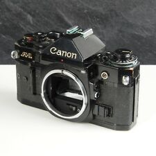 ^ Canon A-1 Black 35mm SLR Camera Body For Parts or Repair 686