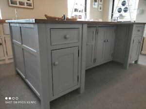 Freestanding Kitchen Island With Pine Worktop And Seating Areas.