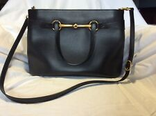 Gucci black leather handbag with gold horsebit detail