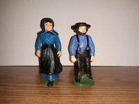 TWO ANTIQUE AMISH CAST IRON FIGURINES - HUSBAND AND WIFE
