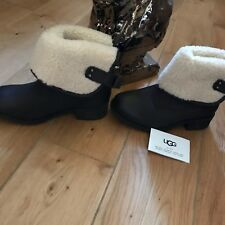 Brown original Ugg boots size 4.5 new with box and authenticity card but small 3