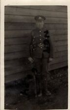 WW1 soldier Lincolnshire Regiment in marching order outside barrack hut