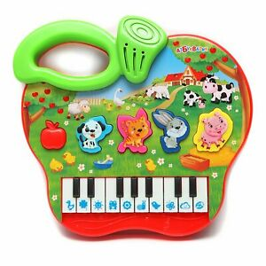 Musical kid's toy piano in the shape of an apple Russian songs melodies & sounds