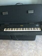 Korg x2 keyboard with case and stand
