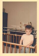 Old Vintage Photograph Adorable Baby Boy Standing In Crib in Retro Room