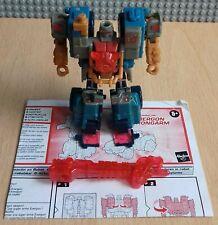 Transformers Energon Strongarm con accesorios y las instrucciones