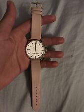 A beige Nine West leather  watch