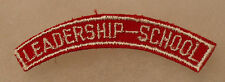 1960'S OBSOLETE NATIONAL GUARD OCS LEADERSHIP SCHOOL TAB WHITE EMB ON RED TWILL