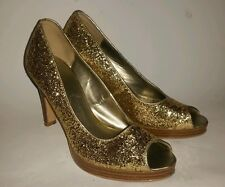 Fioni gold sparkle peeptoe platform cocktail party heels. Size 7.5