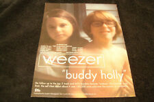 """Weezer tour ad for """"Buddy Holly"""" Rivers Cuomo, Patrick Wilson, Brian Bell, Scott"""