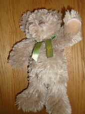 Harrods brown teddy bear with green bow.