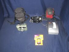 LOT OF FUJI FILM & POLAROID CAMERAS WITH FILM AND CASES