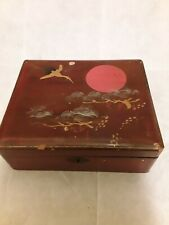 Vintage Japanese victorian lacquered box hinged lid with sun and heron pattern.