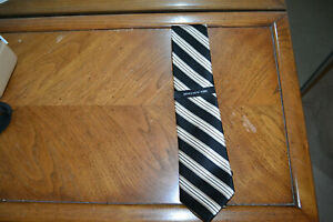 JONES NEW YORK Tie, New with tags, Gold on Black stripes.