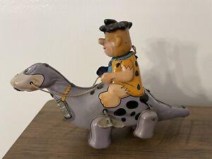 Louis Marx Fred Flintstone Riding Dino the Dinosaur Tin Wind-Up