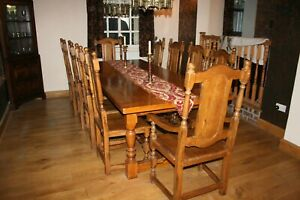 large oak refectory table and 10 chairs