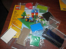 NIP LEGO green baseplate with 9 pkgs of various legos