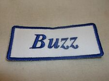 BUZZ NEW EMBROIDERED SEW / IRON ON NAME PATCH BLUE ON WHITE  1.5  X 3.5