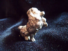 Sweet little silver coloured metal Poodle ornament in begging pose