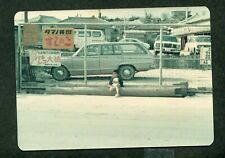Unusual Photo Child Waits Station Wagon Car Behind Fence w/ Signs Japan 991074