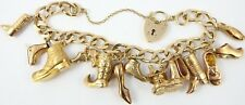 Unusual 9ct solid gold charm bracelet with a variety of 13 shoe and boot charms.