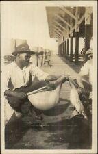 Black Americana Florida - Man & Dead Pelican Bird St. Petersburg? Rppc dcn