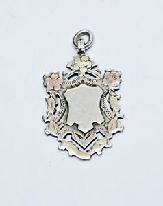 1904 SOLID SILVER FOB WITH GOLD HIGHLIGHTS  FOR A POCKET WATCH CHAIN.