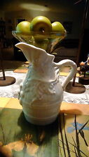 White ceramic pitcher with grape vine design made in France