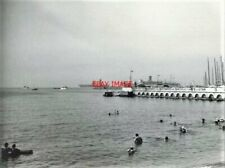 PHOTO  VIEW FROM THE BEACH OF CANNES (DURING A SCHOOL HOLIDAY) OF OCEAN LINER 'S