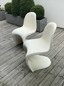 2 S Shaped Stacking Chairs