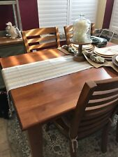 Solid wood casual dining set with six chairs and a leaf to expand the table