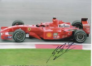 Michael Schumacher signed photo. Ferrari 2001. COA. 21X15