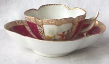 C19TH HELENA WOLFSOHN CUP AND SAUCER WITH SCENES OF BATTLE CANON AND HORSES