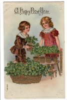 1909 antique postcard Happy New Year embossed w/ children and clover, 1C stamp