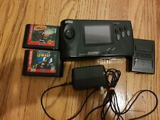 Sega Nomad Handheld Game System W/ BATTERY PACK ***official power cord***+ games