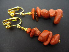 A PAIR OF GOLD PLATED BROWN GOLDSTONE  CHIPS DANGLY CLIP ON EARRINGS. NEW.