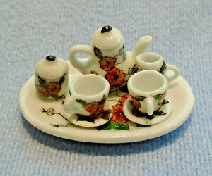 10 PC MINIATURE CHILD'S WHITE OVAL WITH RED FLOWERS TEA SET